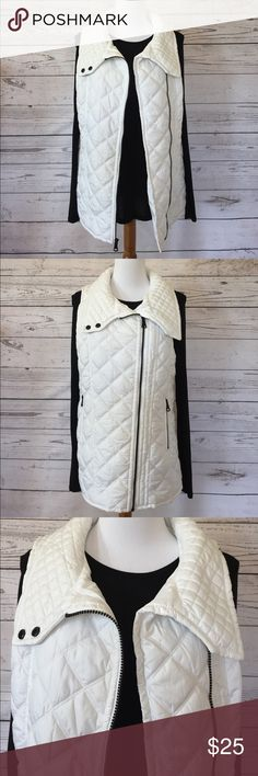 🆕 MARC NEW YORK ANDREW MARC Quilted Vest MARC NEW YORK ANDREW MARC white quilted vest in size small (4-6).  Back Body Length (in): S =26 ½.  Zips up front with two side zipper pockets.  Small inside hidden pocket and button collar.  100% polyester shell/lining/filler.  No trade or modeling, but questions always welcome.  Happy Poshing! Andrew Marc Jackets & Coats Vests