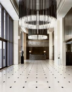 Straight lines and symmetry - this lobby is almost too perfect Mid-century Interior, Interior Barn Doors, Modern Interior Design, Commercial Design, Commercial Interiors, Luxury Lighting, Lighting Design, Modern Lighting, Lighting Ideas