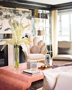 17 Beautifully Feminine Rooms to Get Inspired By// black lacquered walls, pink coffee table