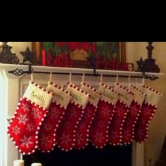 I love this idea.  Whoever thought of it is a genius.  Use only 2-3 stocking hangers and a curtain rod so as your family grows you don't have to worry about finding hangers that match your old ones.