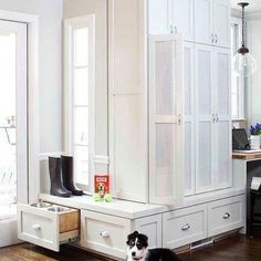 Beautiful mud room design with white cabinets, hardwood floors, benches and cubbies with doors for each member of the family Mudroom Cabinets, White Laundry Rooms, White Shaker Cabinets, Grey Countertops, Hardwood Floors, Flooring, Crate Furniture, Dog Rooms, Floor Colors