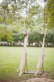 Wooden swing to hang from tree with flowers and ribbon-love!