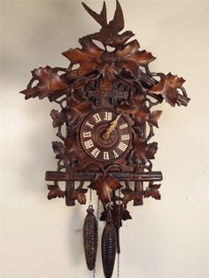 Unusual Cuckoo Clocks 19th, century black forest oak case double fusee bracket cuckoo