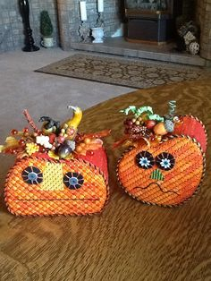 These pumpkins have turned into my favorite things to finish. Two more stitched by Laura, Melissa Shirley designer.