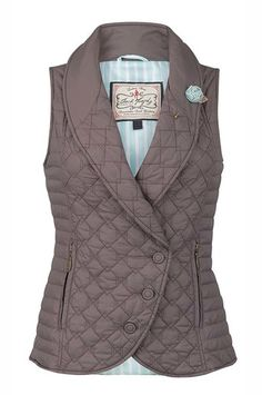 Jack Murphy Ladies Madison Gilet. A beautiful quilted vest with roll collar makes for a warm mid-layer. The stripe print lining adds a pop of color and the rosette pin adds a touch of feminine charm.