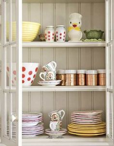 Collections dress up a kitchen cupboard.