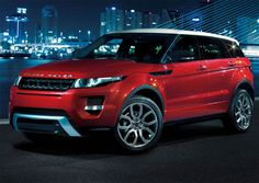 Red New  2012 Range Rover - Husband didn't think the Toyota FJ was luxury enough. How about this??? I like : )