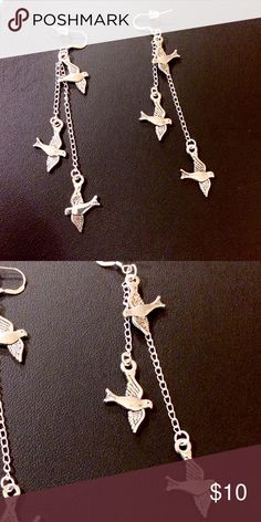 Dove, bird chain dangle earrings These are made with 925 Sterling silver ear wires and plastic earring stoppers. They hang 3 inches. Made with Tibetan silver doves and silver plated chain. Handmade by me NWOT Jewelry Earrings