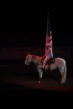 San Angelo, Tx. Marissa Griffin, San Angelo Stock Show and Rodeo Drill Team ambassador, presents the American Flag at the beginning of the San Angelo Stock Show and Rodeo's Military Appreciation Night at the Foster Communication Coliseum here Feb. 26th. (U.S. Air Force photo by Airman 1st Class Breonna Veal) (2848×4288)