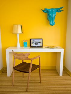 yellow + turquoise office. The turquoise head on the wall. Ha!