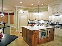 Transitional Kitchens from Jackie Glisson on HGTV  LOVE the light spring green paint color. Would be great color for a feature wall in our kitchen.
