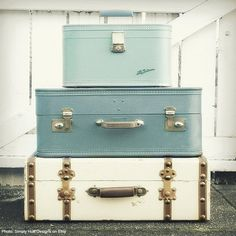 repurposing vintage suitcases as storage, sidetables, nightstands, and vignettes