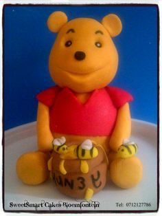 Fondant Winnie the Pooh For more info & orders, email SweetArtBfn@gmail.com or call 0712127786 Fondant Cupcakes, Fondant Figures, Cupcake Toppers, Winnie The Pooh, Icing, Cake Decorating, Teddy Bear, Plastic, Toys