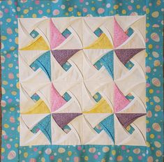 Pinwheel Surprise Quilt Block Pattern from Jaded Spade Creations.  Stunning spinning pinwheels created from an easy-to-follow pattern.