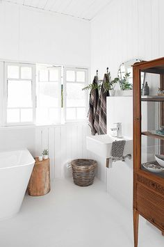 Modern white bathrooms. Photography by Anastasia Kariofyllidis. Styling by Simone Barter.