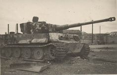 Damaged and abandoned Panzer VI Tiger of the Schwere (SS) Panzer-Abteilung 102, Rouen, France. This image is taken in 1944.