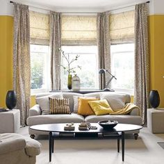 Yellow and grey living room. Love the window treatment.