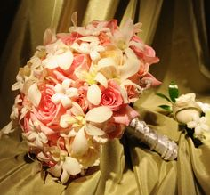Lite pink rose bridal bouquet with touches of crystal orchids. #wedding #flowers #bride #bouquet