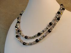 Multi-strand retro black and clear AB glass necklace on Etsy, $40.00