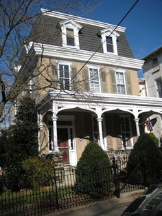 Philadelphia Mansard. Built as the parsonage for the Baptist Church next door, the first two stories were built in 1850 in the Italianate style of Victorian architecture. The third story, with its mansard roof, was added in the 1880s/90s.
