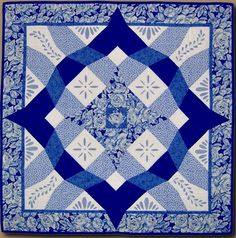 Delft Storm, 39 x 39, by Ionne McCauley.  A storm-at-sea quilt.