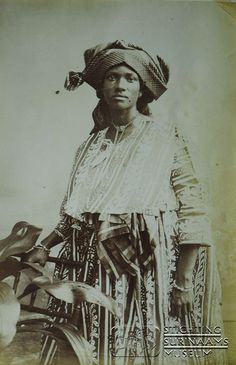 "Vintage ca 1903, African Surinamese woman in ""koto"" outfit, so she is called a ""kotomisi; a miss/mrs in a koto"""