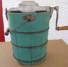Old Fashion Ice Cream Maker.    You use cream, salt and turn the crank for about 30 minutes.