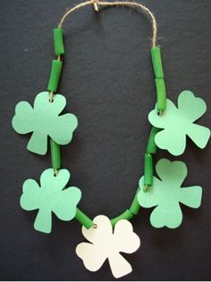 Lucky Charm Necklace Wear green for St. Paper shamrocks and painted noodles fit perfectly together on a piece of string to create this lucky charm necklace. The post Lucky Charm Necklace was featured on Fun Family Crafts. March Crafts, St Patrick's Day Crafts, Daycare Crafts, Classroom Crafts, Preschool Crafts, Holiday Crafts, Kids Crafts, Craft Activities, Family Crafts