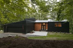"""Freshly renovated Mid-century Home """"after"""" exterior of 7 Middle Shore Drive in Madison NH"""