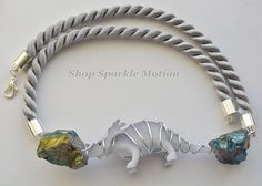 Items similar to Pastel Lilac Dinosaur Silver Crystal Wire Wrap Pendant Cord Necklace on Etsy Crystal Collection, Dinosaurs, Turquoise Bracelet, Lilac, Sparkle, Wire, Pastel, Crystals, Bracelets
