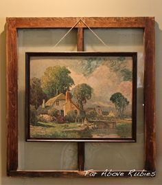 make a picture stand out by hanging on old window hanging on wall.