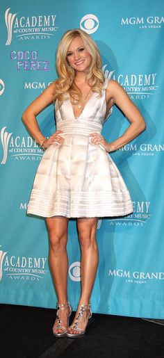 Google Image Result for http://i.cocoperez.com/wp-content/uploads/2010/12/carrie-underwood-talking-on-her-style__oPt.jpg