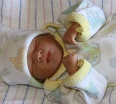 This one looks like a real newborn baby huh? It is made of Polymer Clay too.