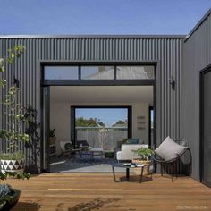 Use of colourbond cladding in black, with black windows and deck from the Brunswick Extension Metal Cladding, Corrugated Roofing, Native Design, Black Windows, Steel Buildings, House Roof, Facade House, Shed Plans, Woodworking Projects Plans