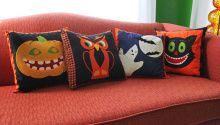 I love working on a small project that can be finished in one sitting - one that you can use year after year to spice up your holiday décor - and pillow covers are just the thing! I looked at a variety of vintage Halloween decorations and came up with four patterns for fun pillow shams.
