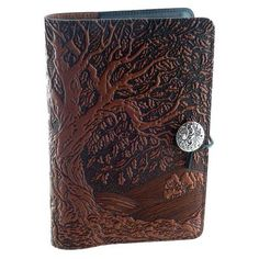 "Large Ancient Oak Tree Leather Journal - Massive oak tree design actually continues on the spine and back of this journal. Pewter button has oak leaf and acorn. The journal measures 6"" by 9"". #JournalsPens #LeatherBoundJournals #TreesGreenman #GryphonsMoon"