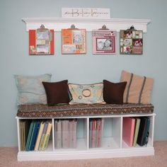 Love how the albums are stored under the bench and the display of favorite pages on the wall.