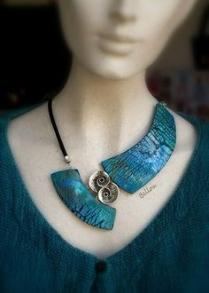 Polymer clay artists make some incredible pieces of art.   The French designer behind Bellou  excels at asymmetrical polymer clay necklaces....