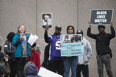 Young speaker at a protest demanding police be prosecuted for the death of Jamar Clark