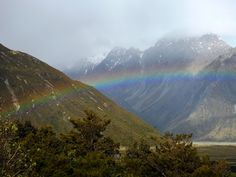 https://flic.kr/p/QKGQmT | 7174ex  P900  Hiking above the rainbow | A wet day with snow and sleet shrouding the higher mountain range.  We were hiking the area, and came across this beautiful rainbow shimmering across from and below us towards the valley floor.  No Mt Cook views this day, but still lots of beauty.  Check back to my album 2016 Australia, New Zealand and French Polynesia   -- should be posting more ( almost) daily  www.flickr.com/photos/25171569@N02/albums/72157676139226736…