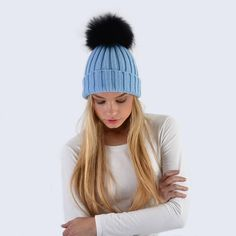 25992065179 Why not mix up your style in this sky blue Amelia Jane London hat and black  fur pom pom