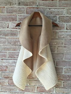 "Made from high quality Minky Faux Shearling. This vest is right on trend for fall!30- 34"" long One side is faux shearling the other is faux suede. Note: if you"