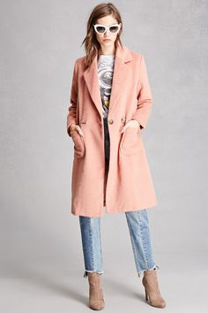 A fuzzy-brushed woven coat featuring a double-breasted front, notched collar, front patch pockets, and long sleeves. This is an independent brand and not a Forever 21 branded item.