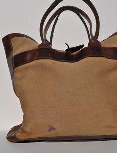 vintage tote bag leather and canvas shoulder bag. $75.00, via Etsy.