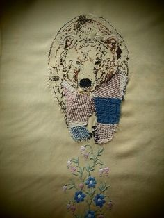 Bear embroidery by Drusilla Pettibone. Hand embroidery, appliqué and quilting with vintage patchwork, embroidery floss and handspun wool on vintage table runner. (Private collection of Sasha Miller)