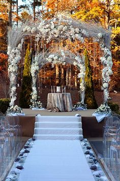 White hydrangeas and branches combine to create a lush altar at this   fall wedding.