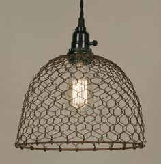 Chicken Wire Dome Pendant Light - Primitive Rust-Lamp is 10 dia. and tall including socket. Plugs into any wall outlet. Shown with our 40 watt vintage bulb, not included. Our pendant lamps include it all: foot cloth-covered lamp cord with s Ceiling Hooks, Ceiling Pendant, Ceiling Lamp, Pendant Lamps, Pendant Lights, Chicken Wire Crafts, Wire Pendant Light, Deco Luminaire, Lamp Cord