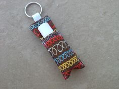 Brown loops fabric lip balm /chapstick holder keychain.