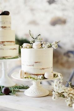Elegant and Rustic Semi Naked Cake with White Spring Blossom and Vanilla Macarons