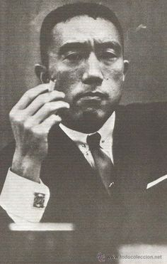 Yukio Mishima smoking and looking thoughtful